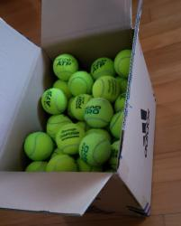 link to A box of used tennis balls