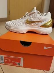 link to Nike Women Air Zoom Cage 3 White/Gold US 7.5